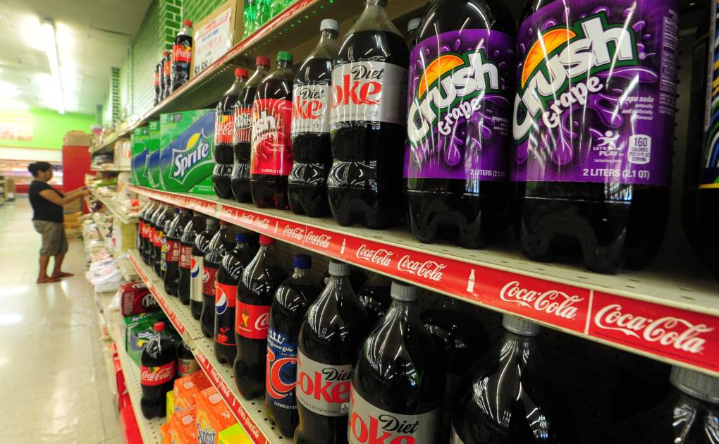 An aisle of soda bottles at a grocery store in California.