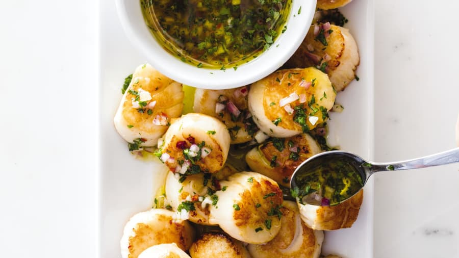 Scallops, pan seared with olive oil (and drizzled with an olive oil, orange, and lime dressing).