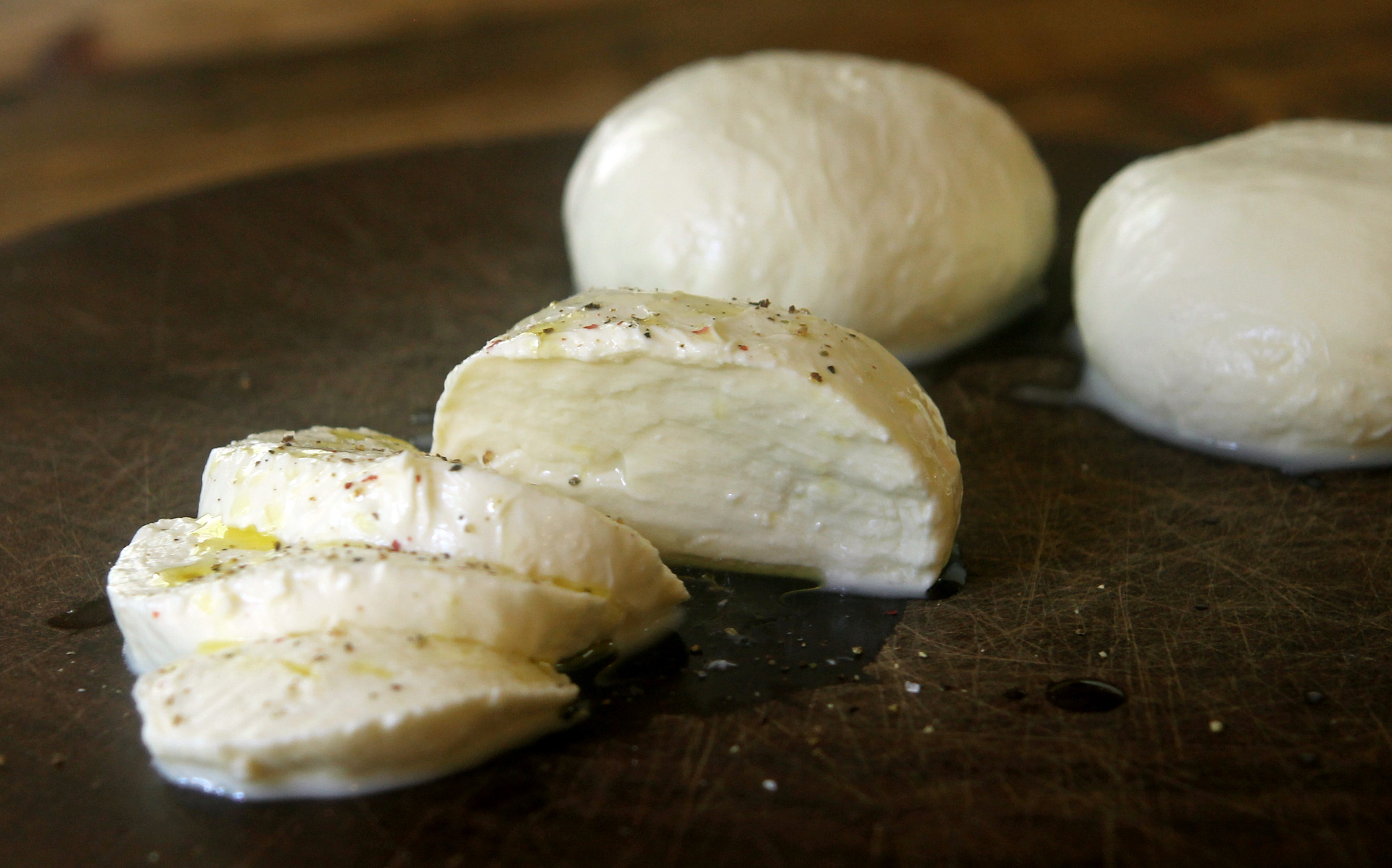 Homemade fresh mozzarella with olive oil and freshly ground pepper