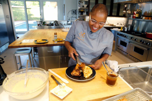 Tanya Holland finishes off the cornmeal waffles to serve with buttermilk fried chicken.