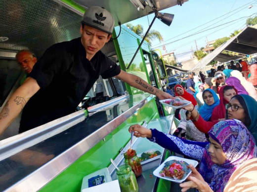 Muslims and Latinos line up for free halal tacos outside a mosque in Rosarito, in Baja California, Mexico, as part of the #TacoTrucksatEveryMosque Crosses the Border event, Sept. 1, 2017. The events seek to foster unity between two communities facing increasing discrimination.