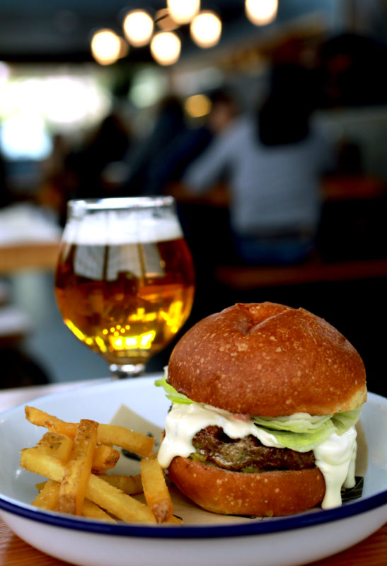 "The Handline ""Inglewood"" burger features pastured beef, St. Jorge fonduta, iceberg lettuce, spicy pickle relish and thousand island on a toasted bun."