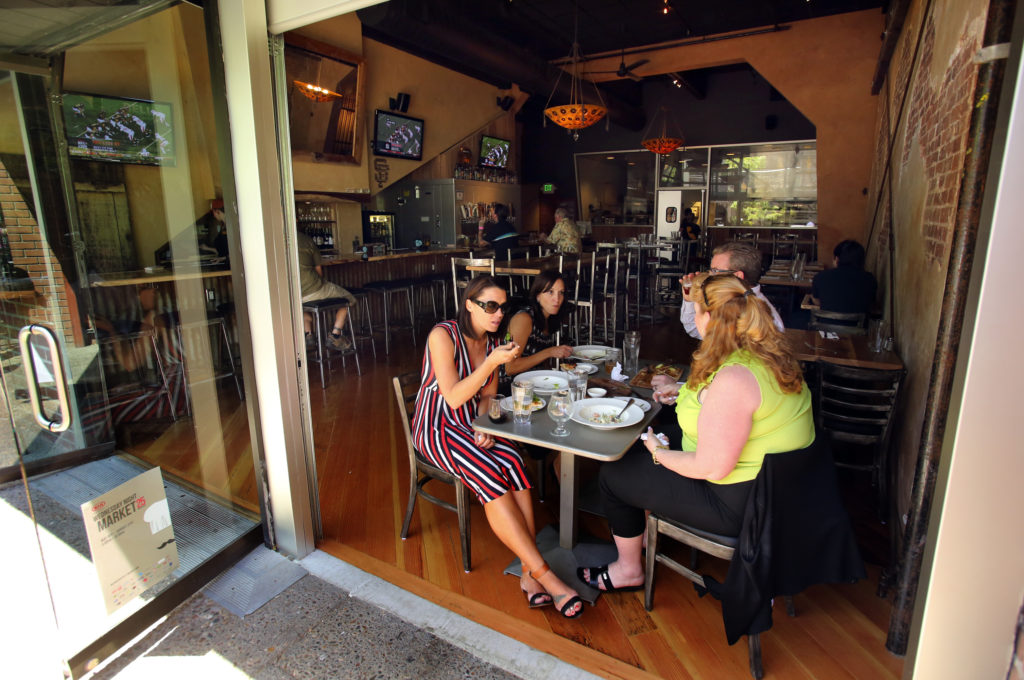 Diners enjoy lunch at the Belly Left Coast Kitchen & Tap Room in downtown Santa Rosa.