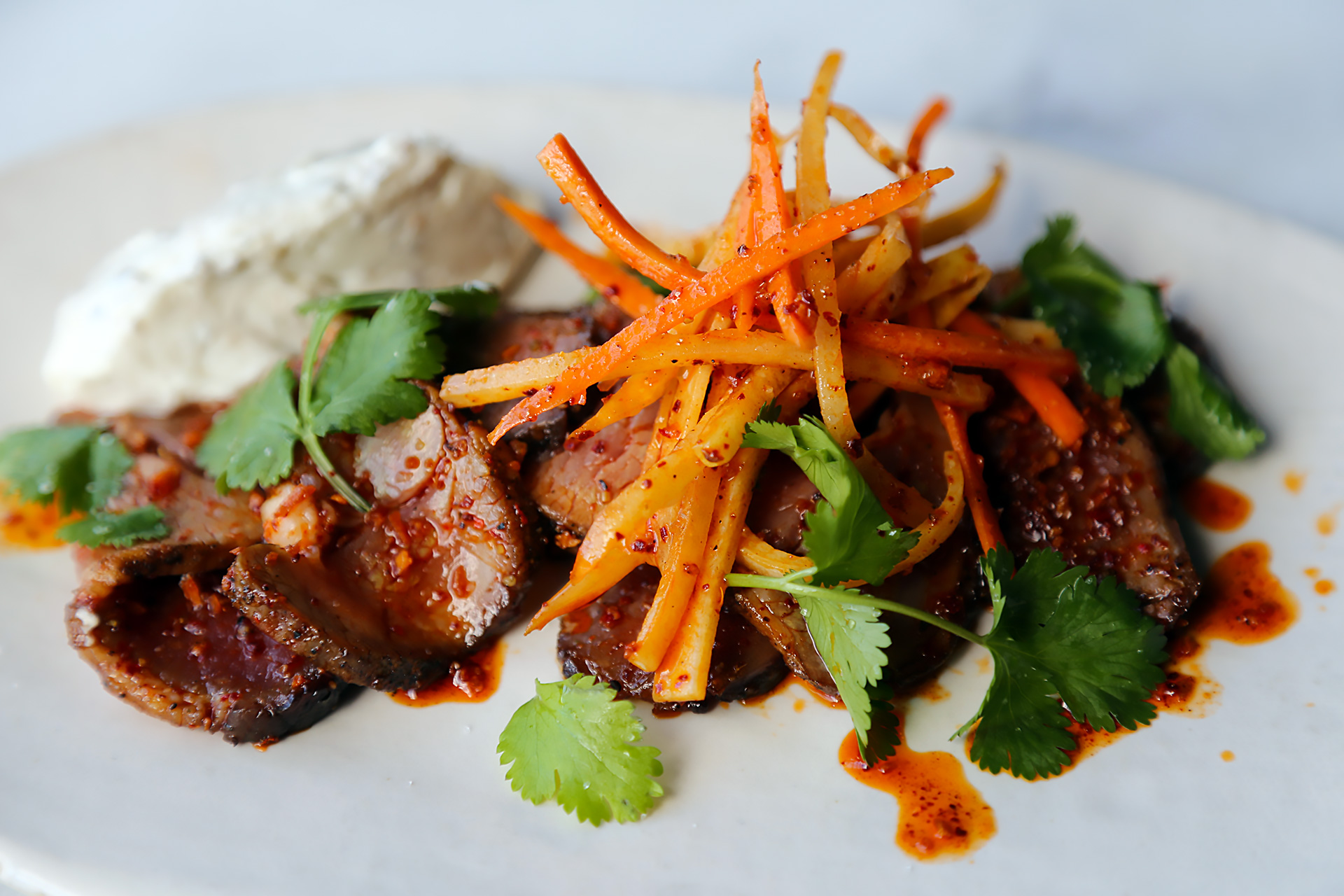 Lamb leg with peppercorn labneh and carrot salad