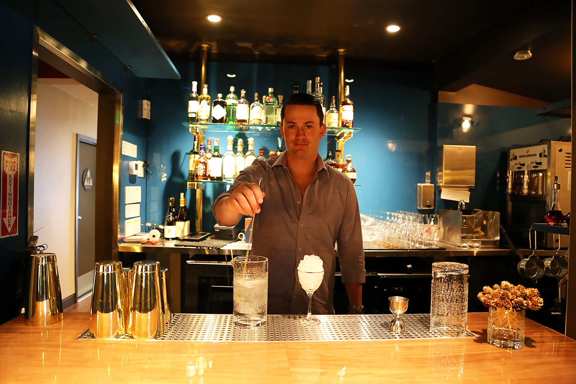 General Manager Tristen Philippart de Foy at the back bar