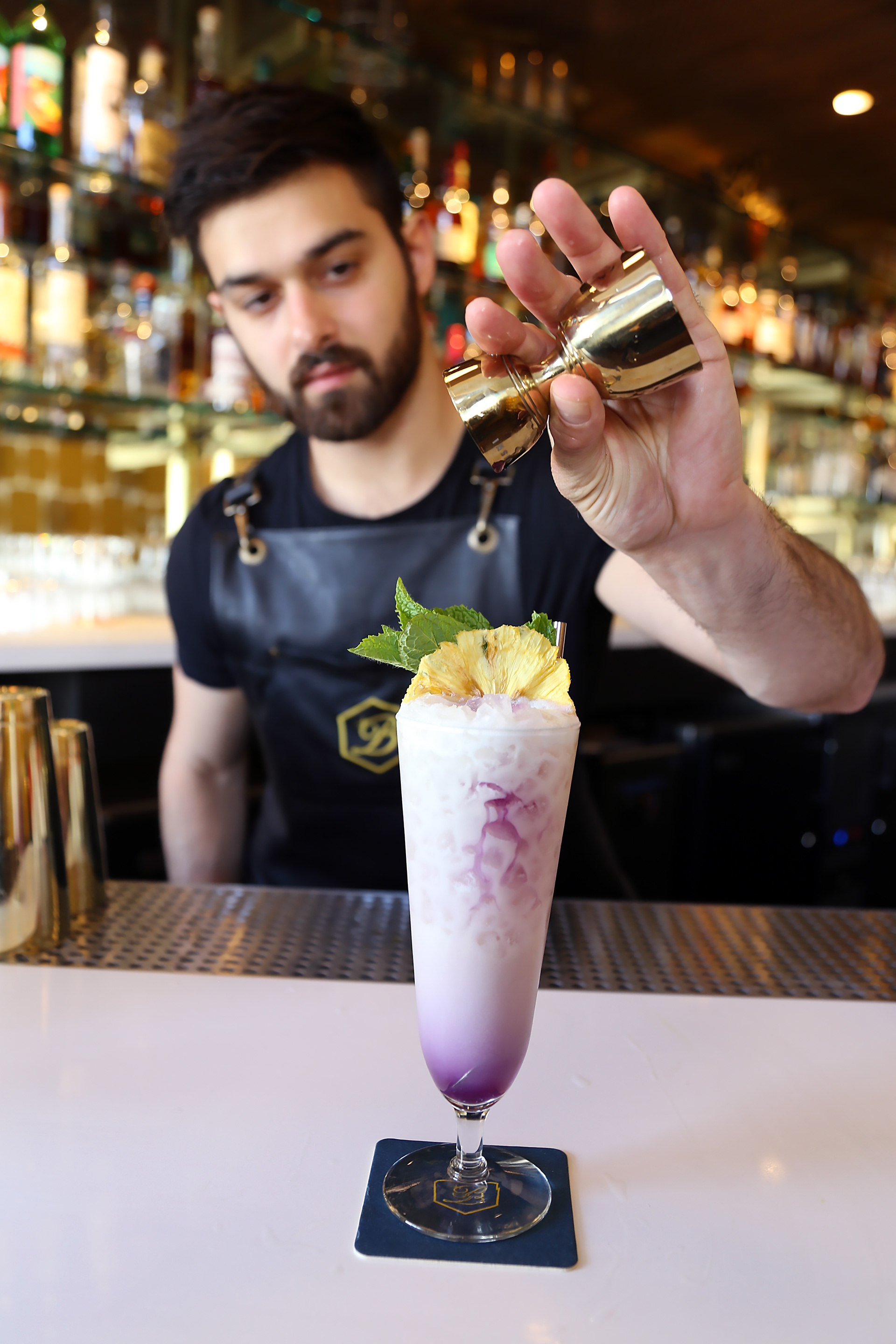 Lead Bartender Emilio Salehi puts the finishing touches on the Bikini Drifter