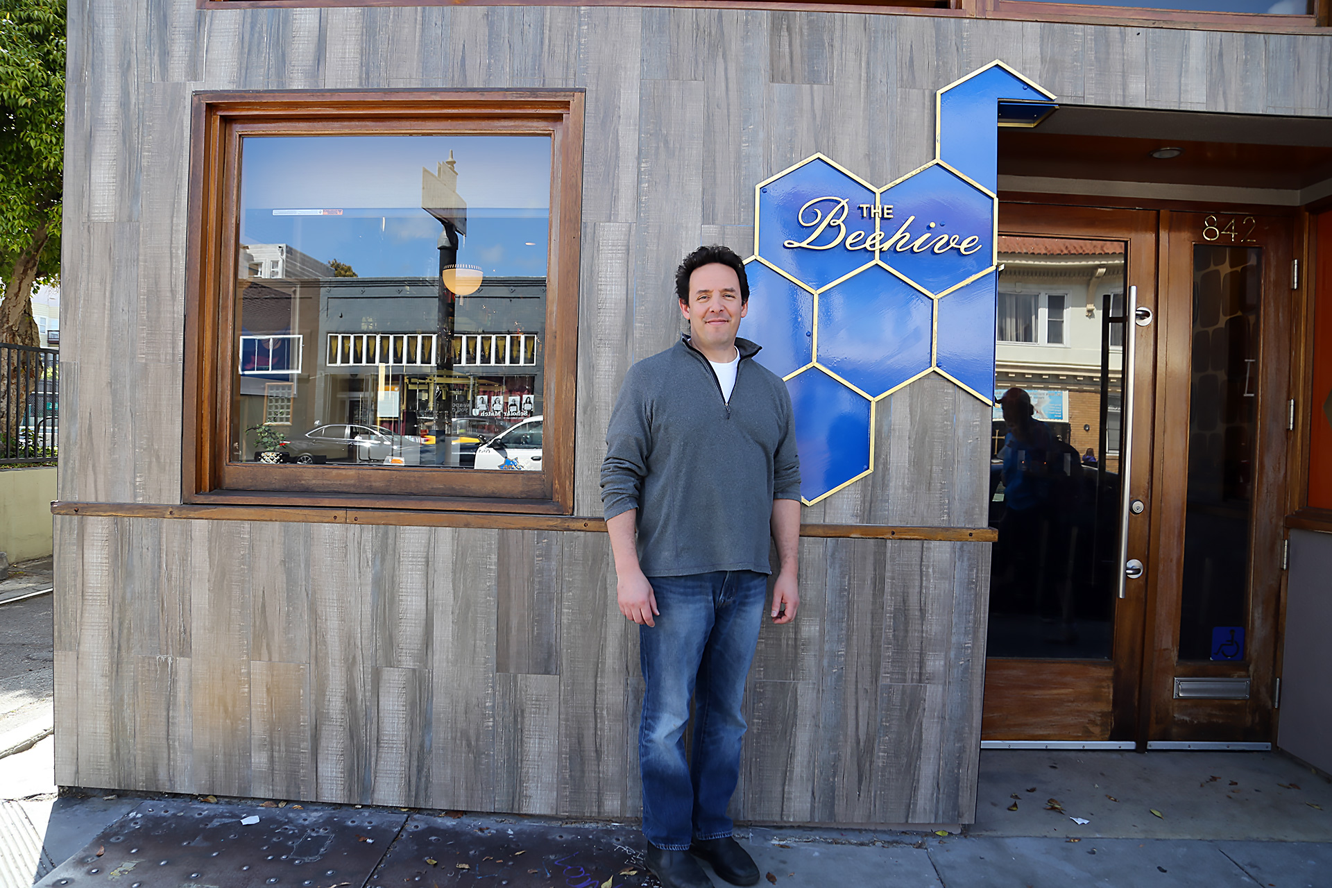 Partner/Chef Phil West in front of The Beehive
