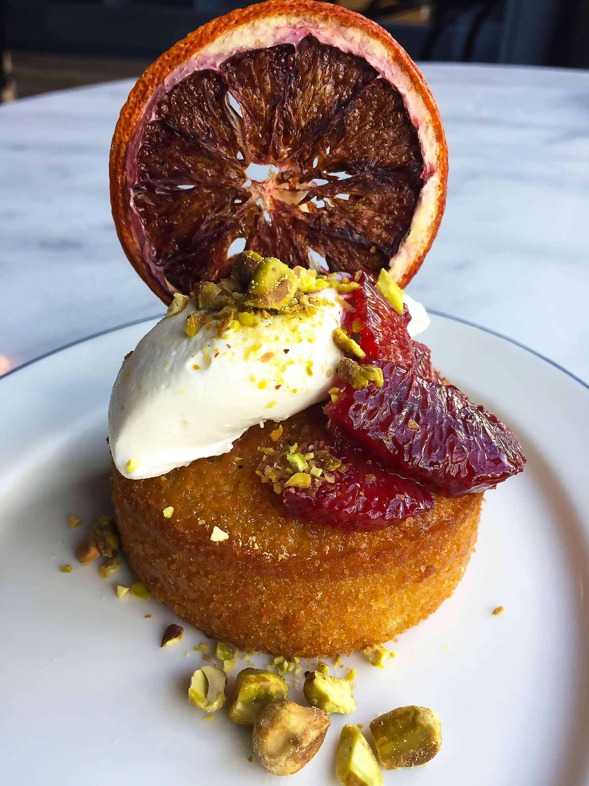 Olive oil cake with blood oranges and pistachios