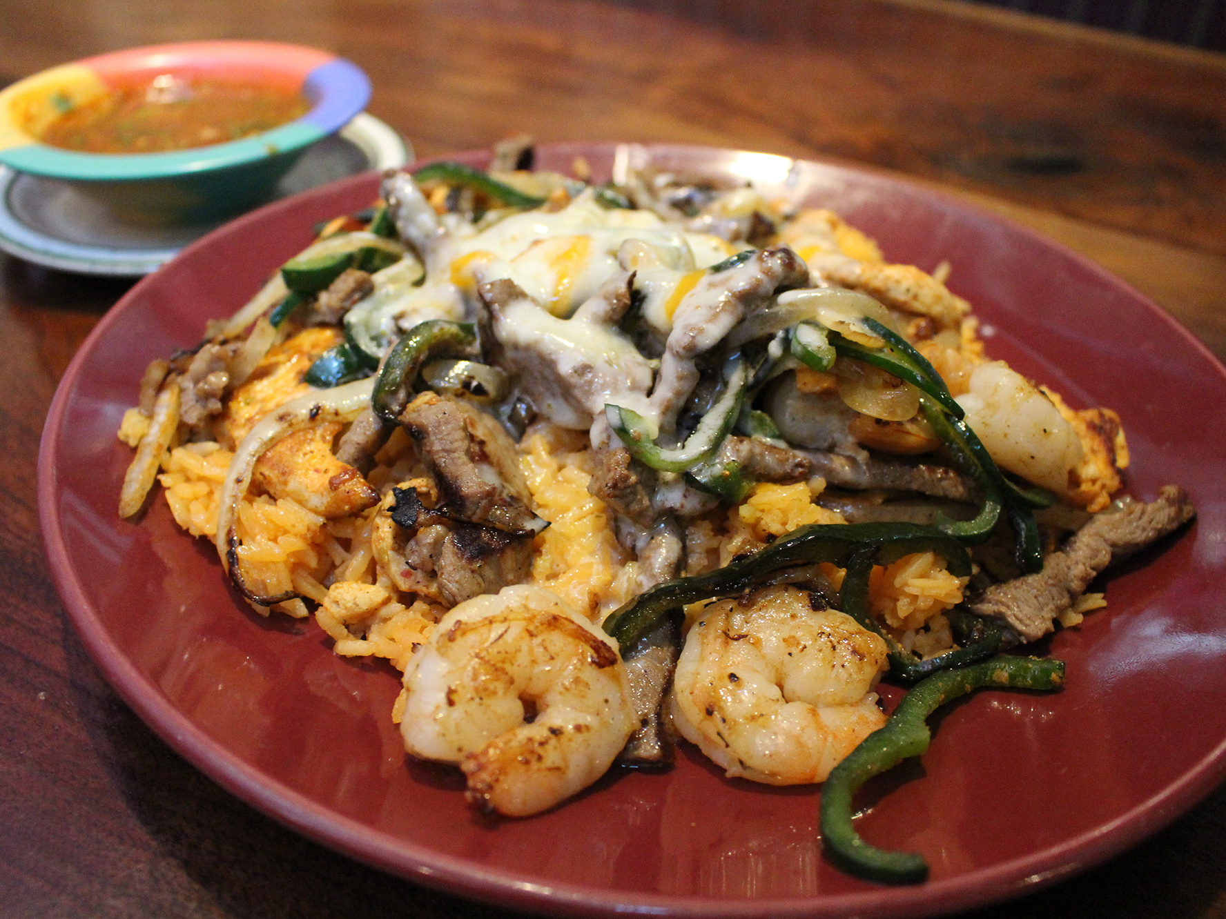 """The ACP dish at La Rancherita in Raleigh, N.C., is delicious, because it uses cheese from Chihuahua, which is milkier and doesn't melt as much. Charlie Ibarra, a restaurateur whose family owns the La Rancherita restaurants, says his father didn't know what ACP was when he started out. """"But we sold it. It paid the bills."""""""