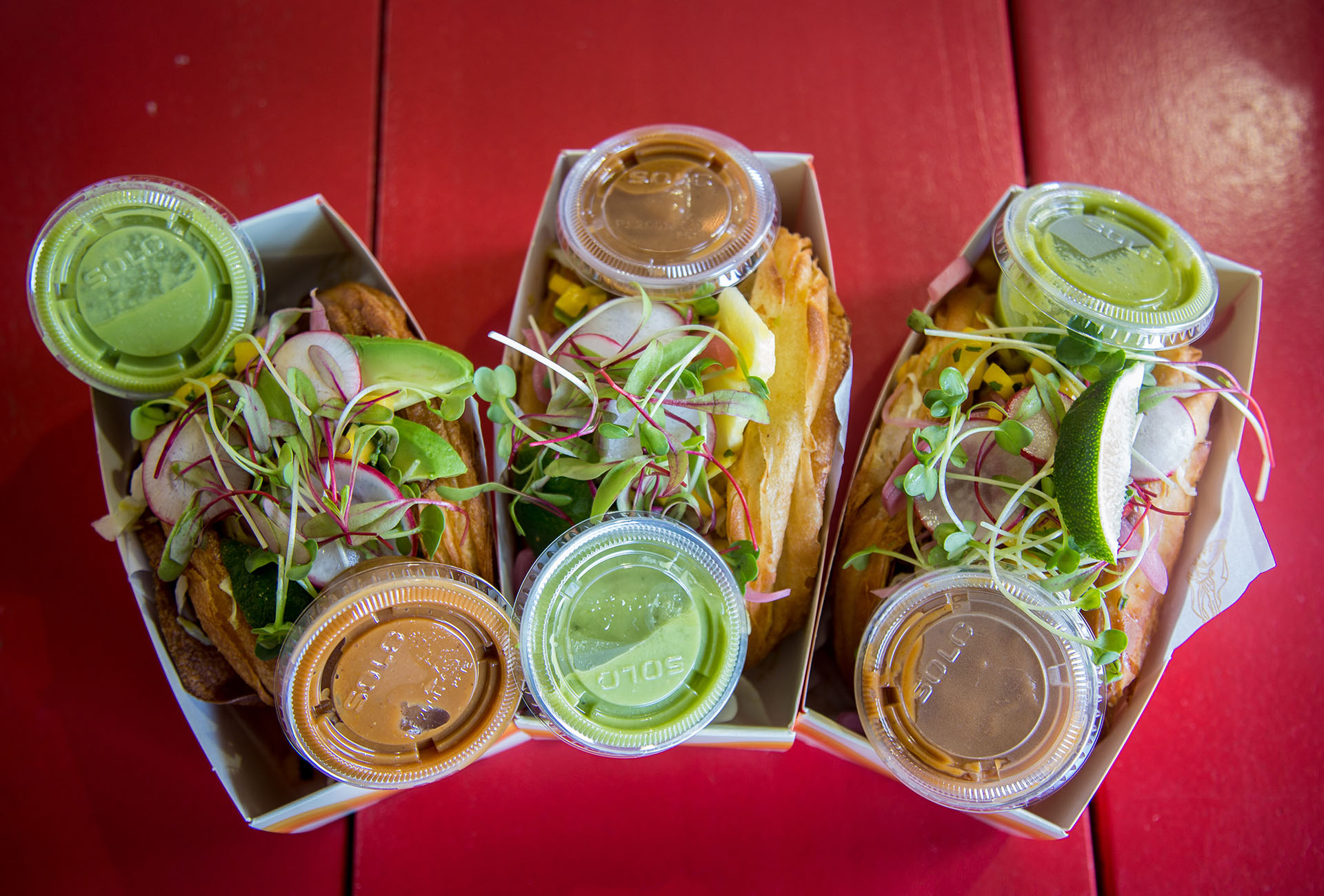 All three varieties of the Tacro including the Jackfruit BBQ, Chicken and Avocado, and Pulled Pork and Pineapple.