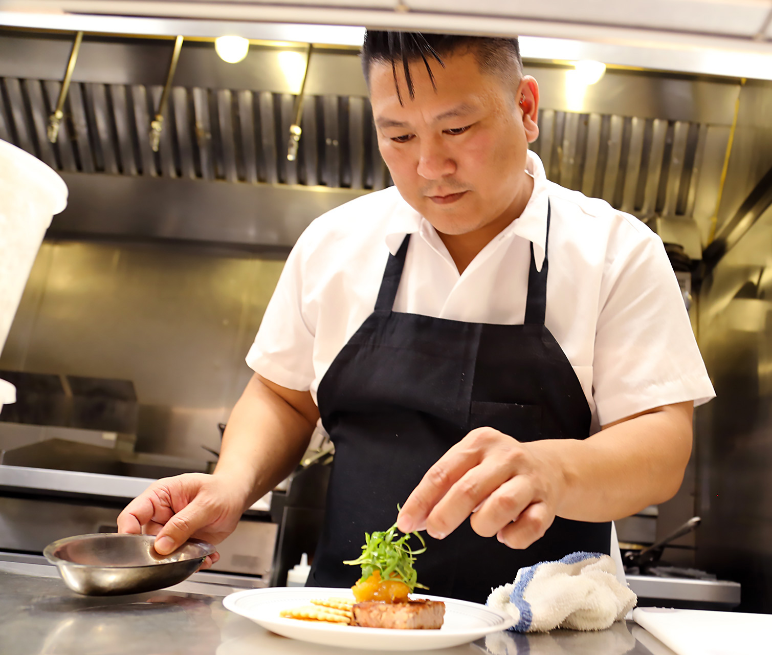 Chef Byron Gee in The Beehive's open kitchen