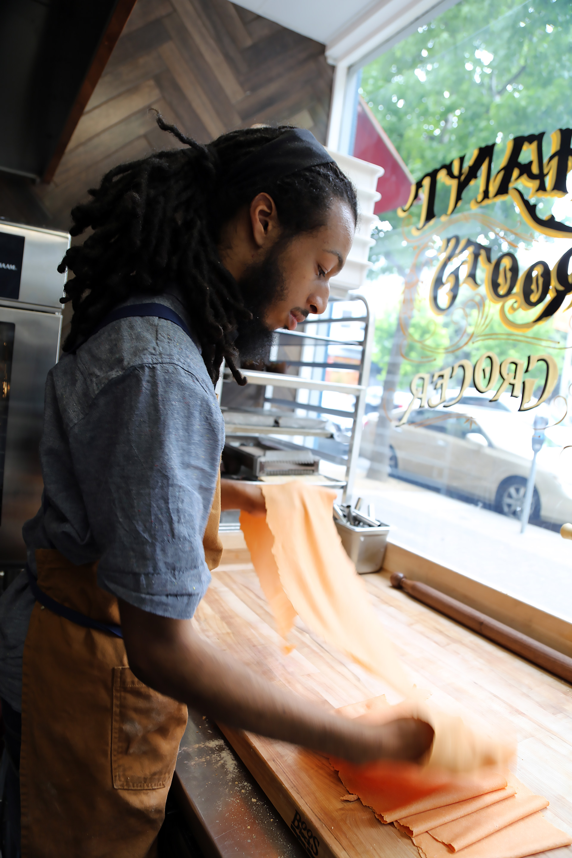 Sous Chef David Hamilton-Kidd making fresh pasta at Merchant Roots