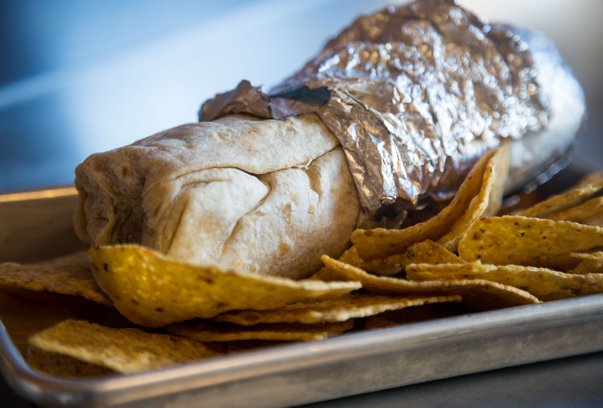 The Fried Chicken Burrito comes with tortilla chips.