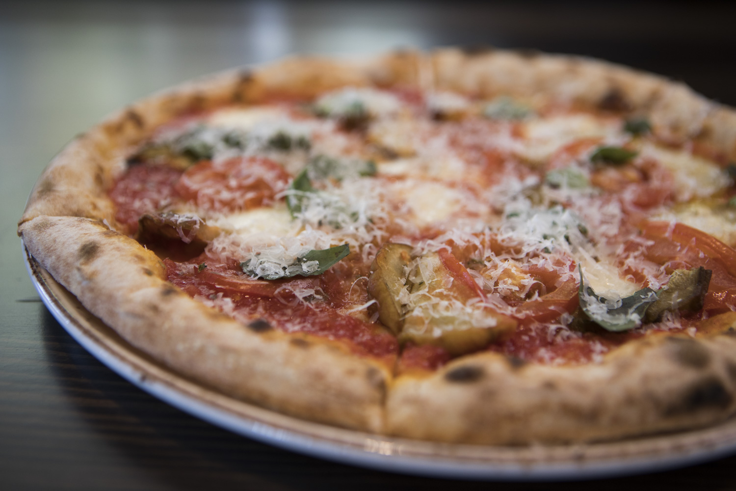 The Parmigiana pizza with fresh mozzarella, eggplant, tomatoes, oregano, basil, Parmigiano-Reggiano.