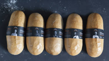 Hate crimes are on the rise in Poland. In response, a new YouTube video aspires to foster tolerance by having people from marginalized groups bake and sell bread to customers at a Warsaw bakery. Above, some of the loaves baked and handed out as part of the campaign. Each loaf is wrapped in a black ribbon with a photo and information about the person who baked it.