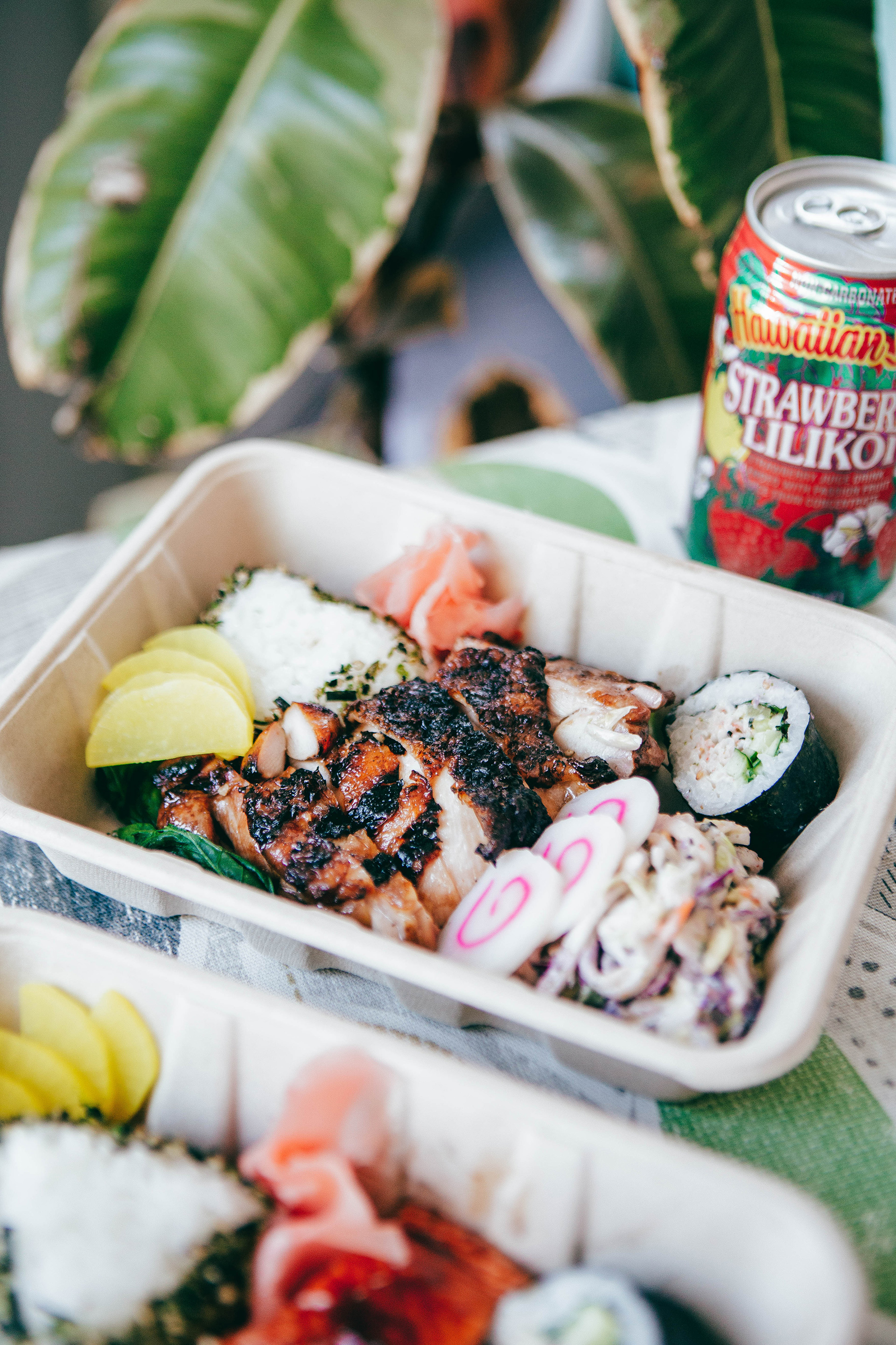 Aina's huli huli BBQ chicken with cucumber sunomono.