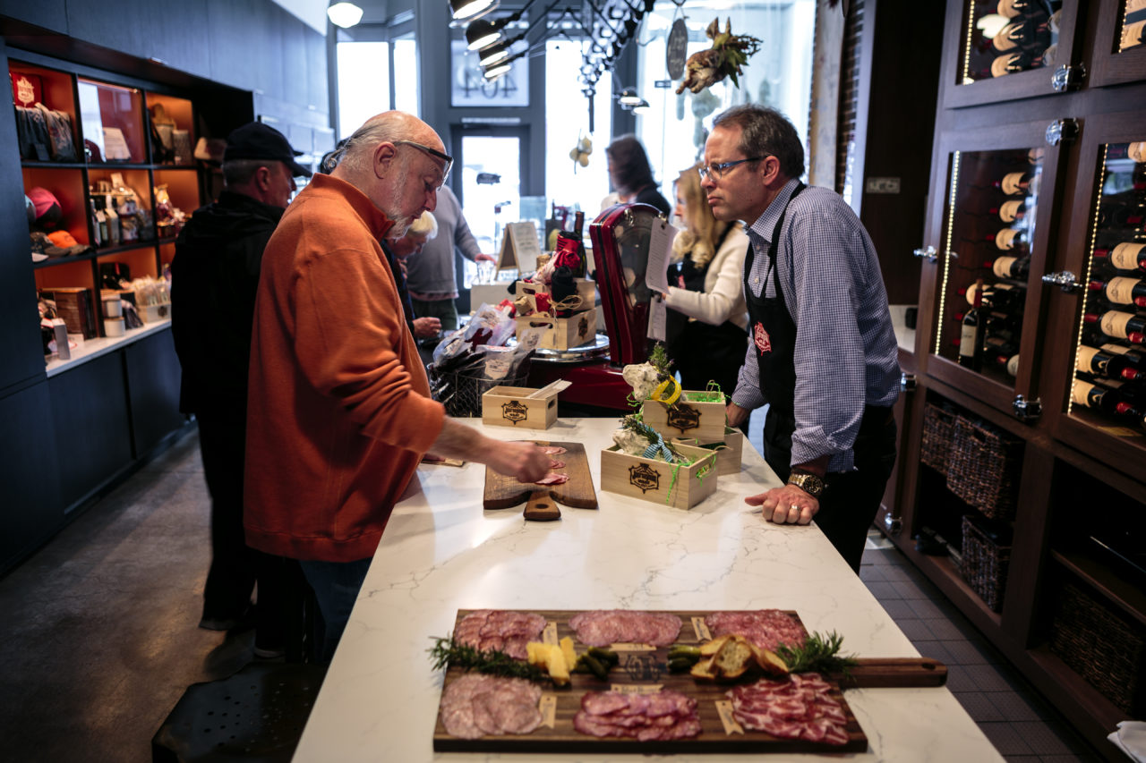 Journeyman Meat Co. owner Peter Seghesio chats with a customer.