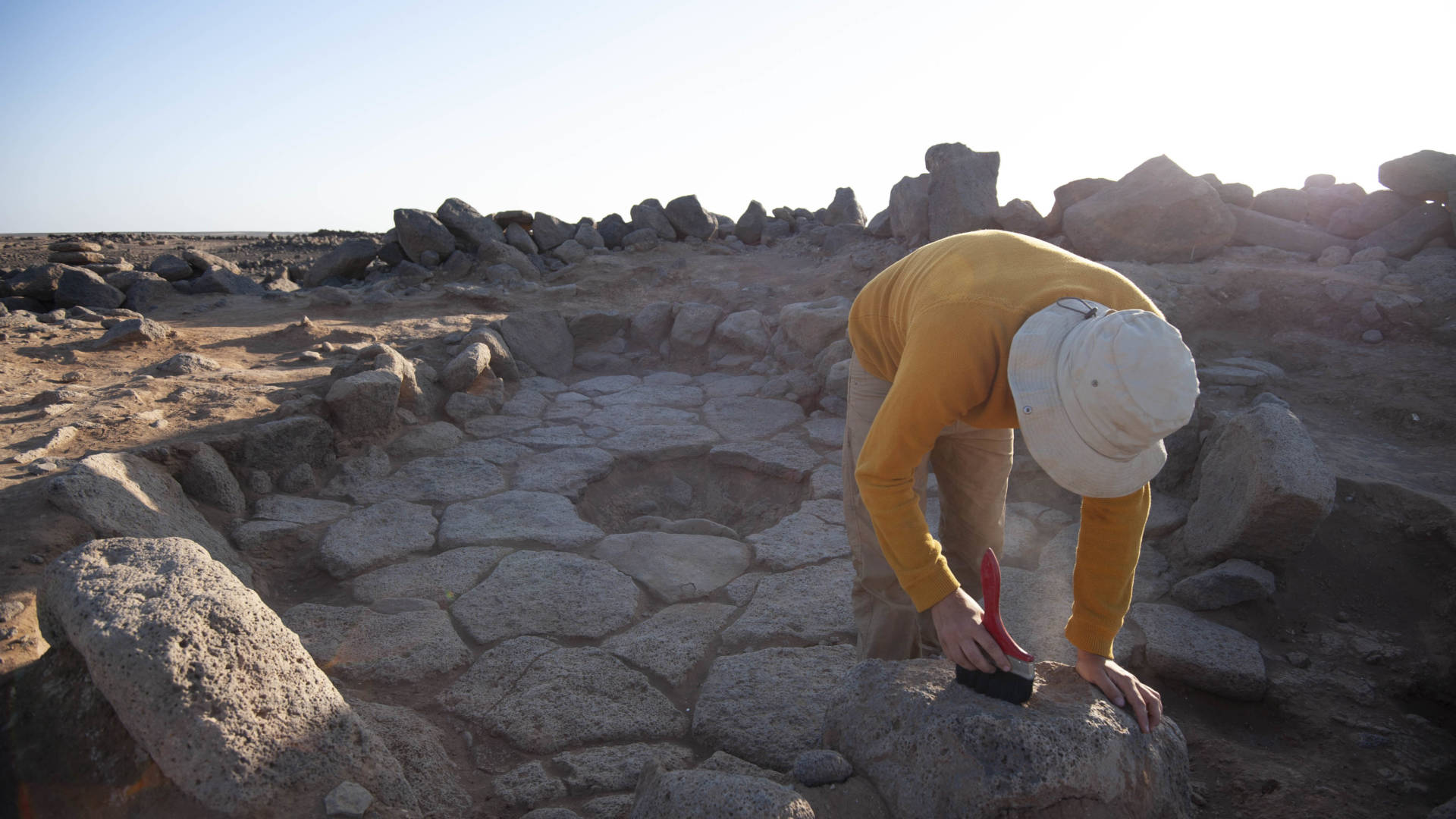 A researcher gathers breadcrumbs at an excavation site in Jordan. The 14,000-year-old crumbs suggest that ancient tribes were quite adept at food-making techniques, and developed them earlier than we had given them credit for.