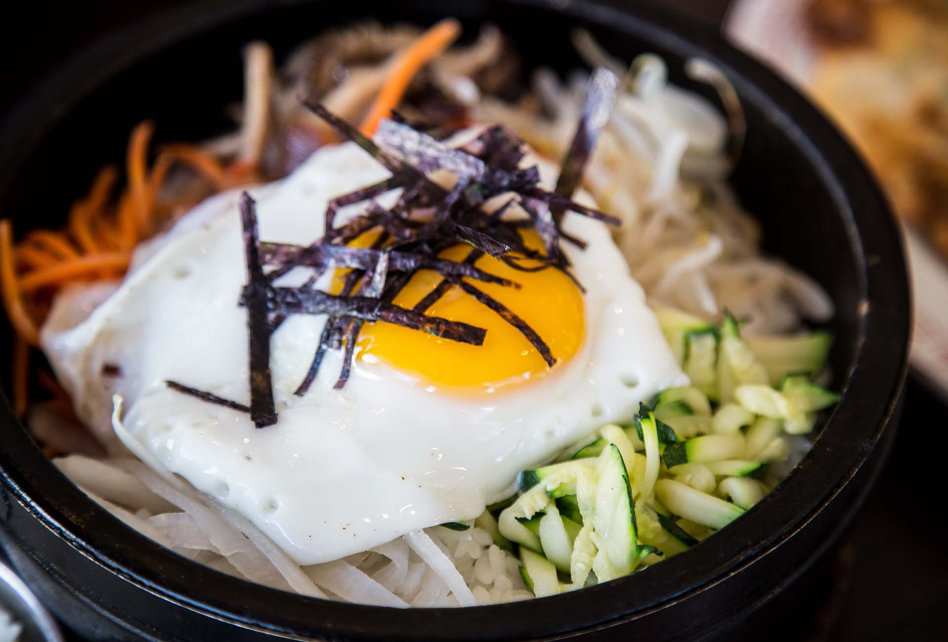 A traditional bibimbap served in a hot stone bowl