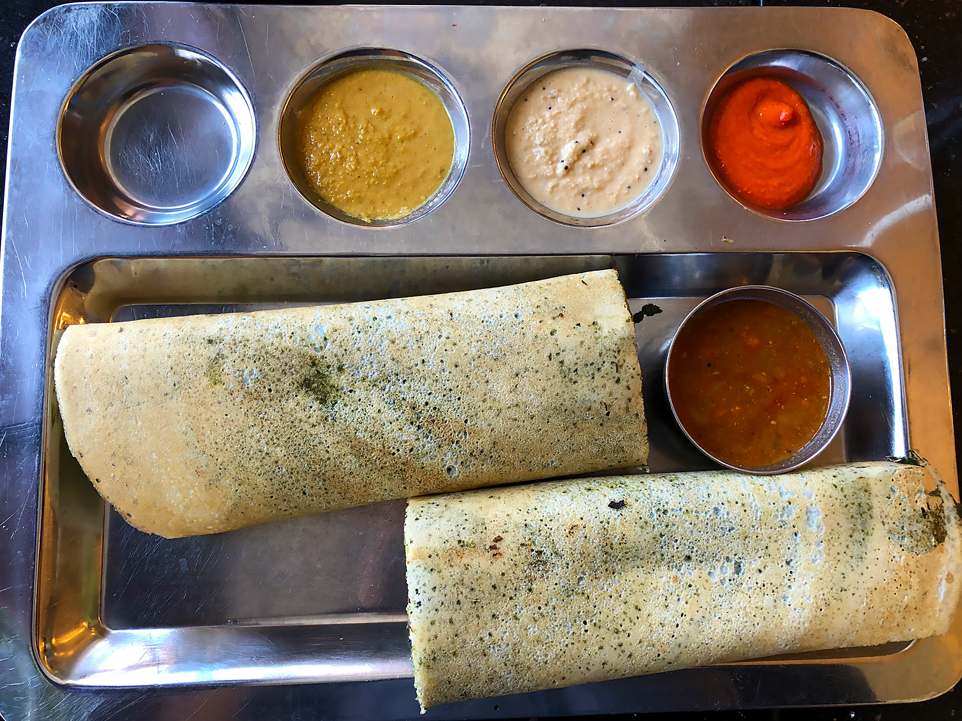 Spinach Masala Dosa - served with Sambar, Coconut, Tomato, & Ginger Chutney ($9.95)