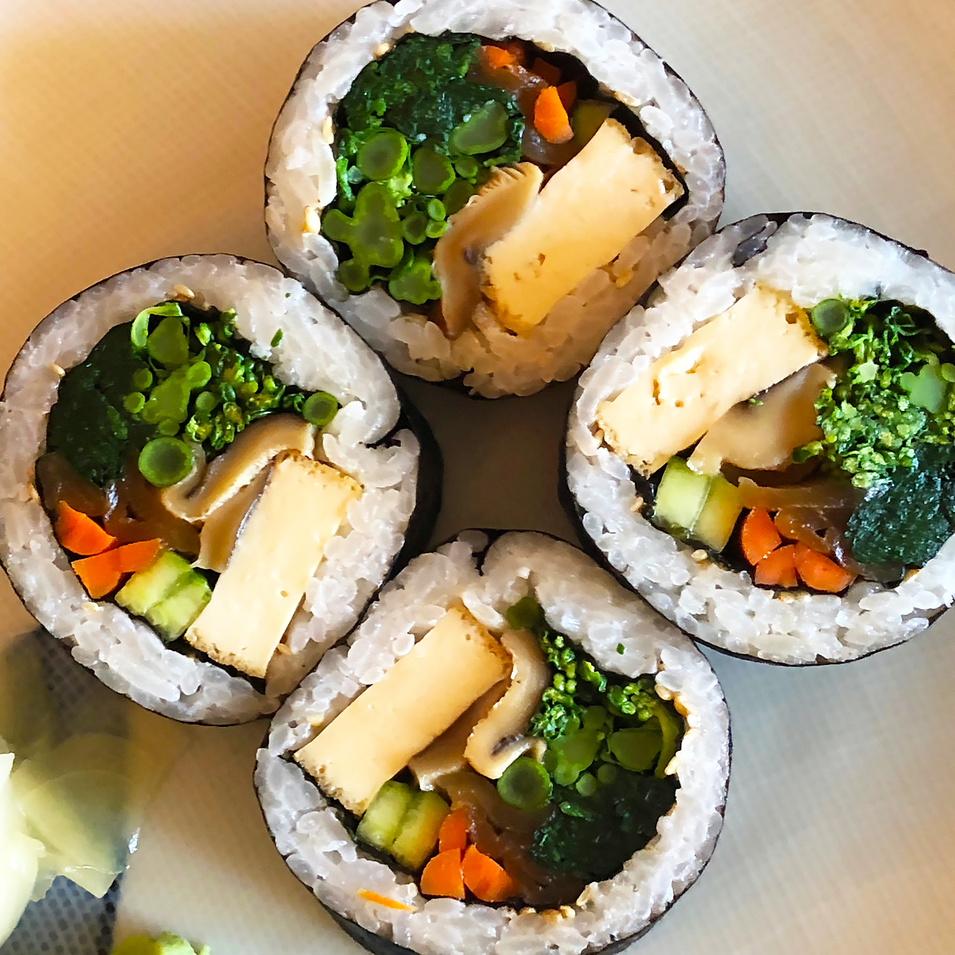 "Cha-Ya Vegan Roll: The traditional ""futomaki"" roll vegan style. Spinach, atsuage tofu, cucumber, broccolini, shiitake, kampyo, yamagobo and ginger. ($10)"
