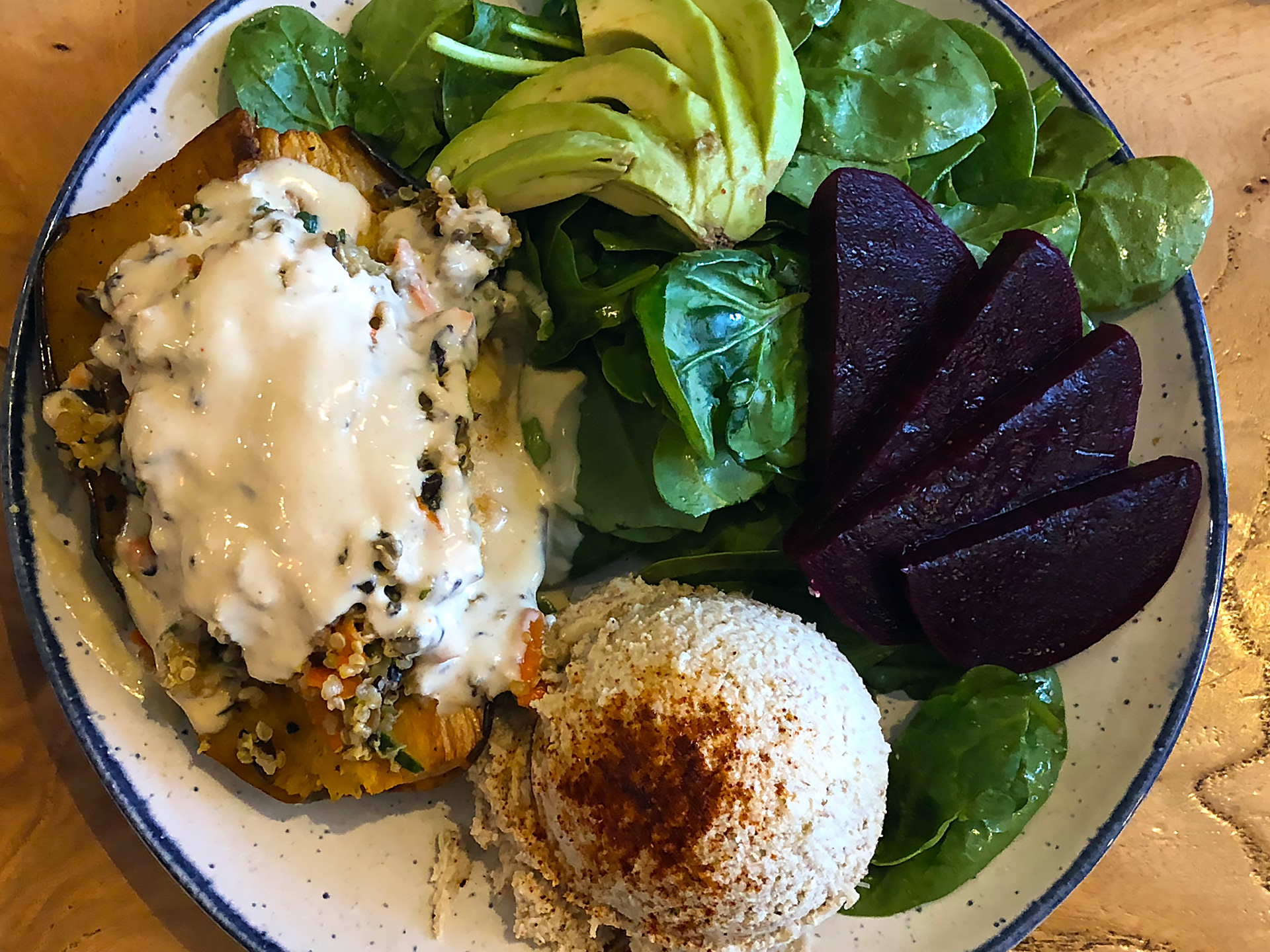 Beloved's Stuffed Delicata Squash ($14): roasted delicata squash stuffed with homemade superfoods quinoa salad, topped with tahini dressing, spinach salad, avocado, beets and hummus.