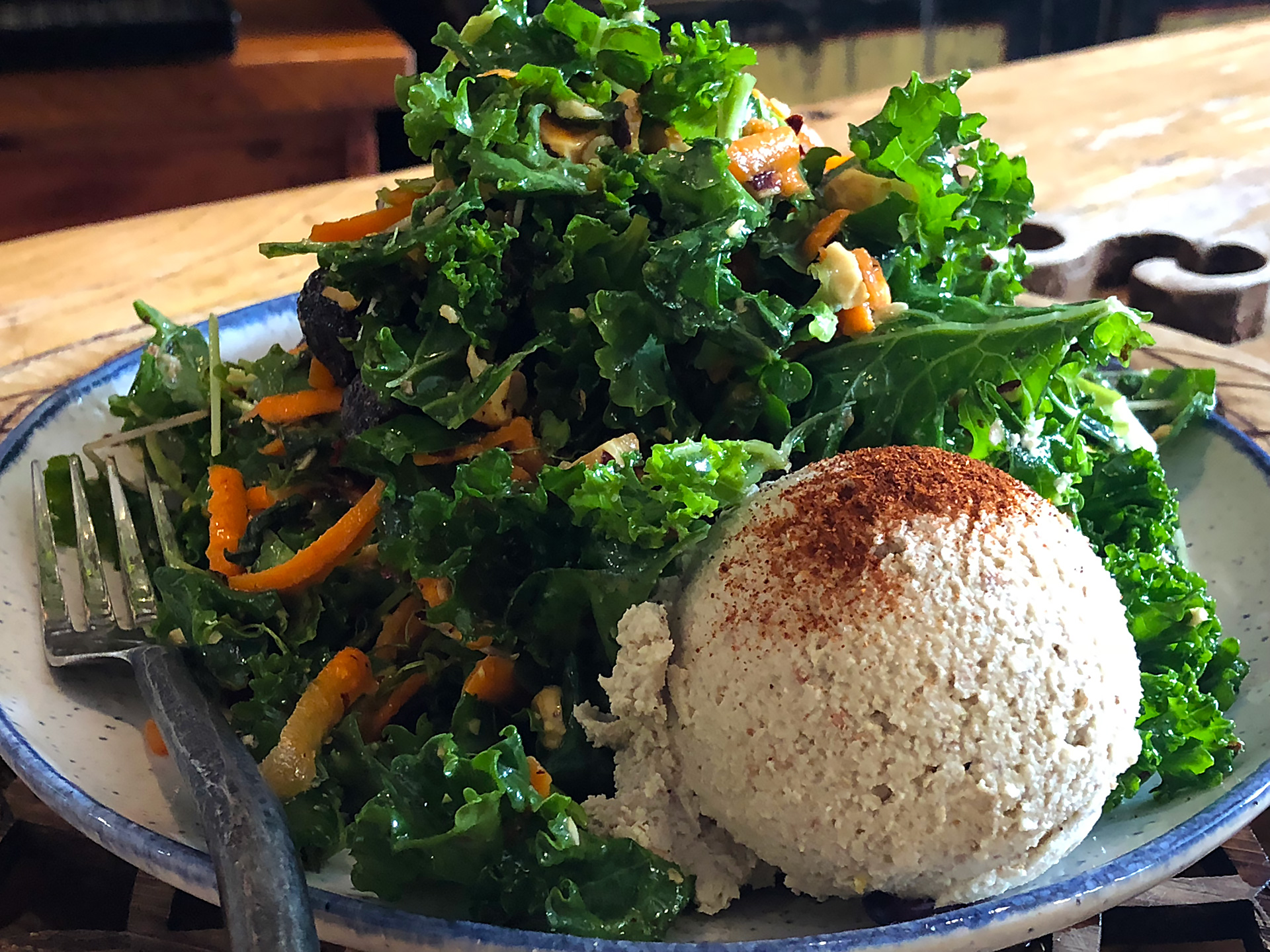 Citrus Hazelnut Kale Salad: kale, carrot, sprouts, orange slices, toasted hazelnuts, dried figs, in an apple cider vinaigrette. ($12) Add avocado, hummus, Rhizocali tempeh ($2)