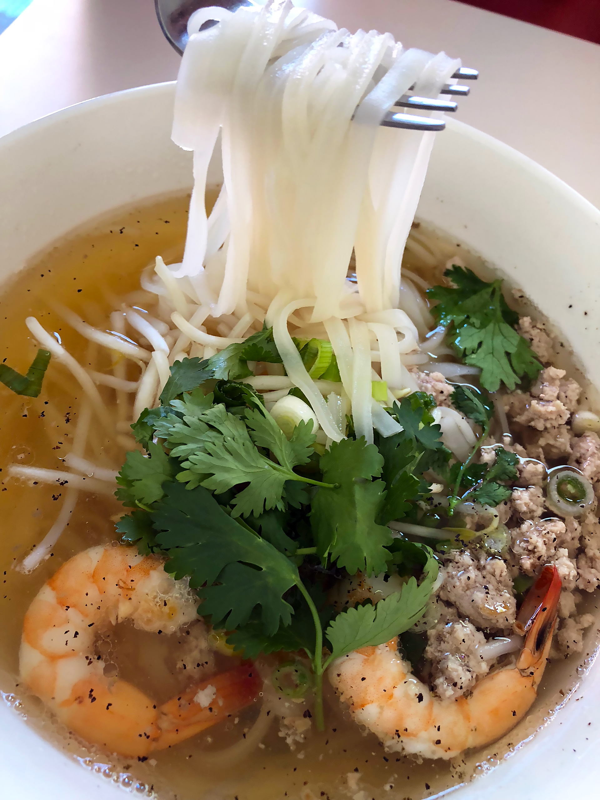 Kuy Teav Phnom Penh with noodles displayed.