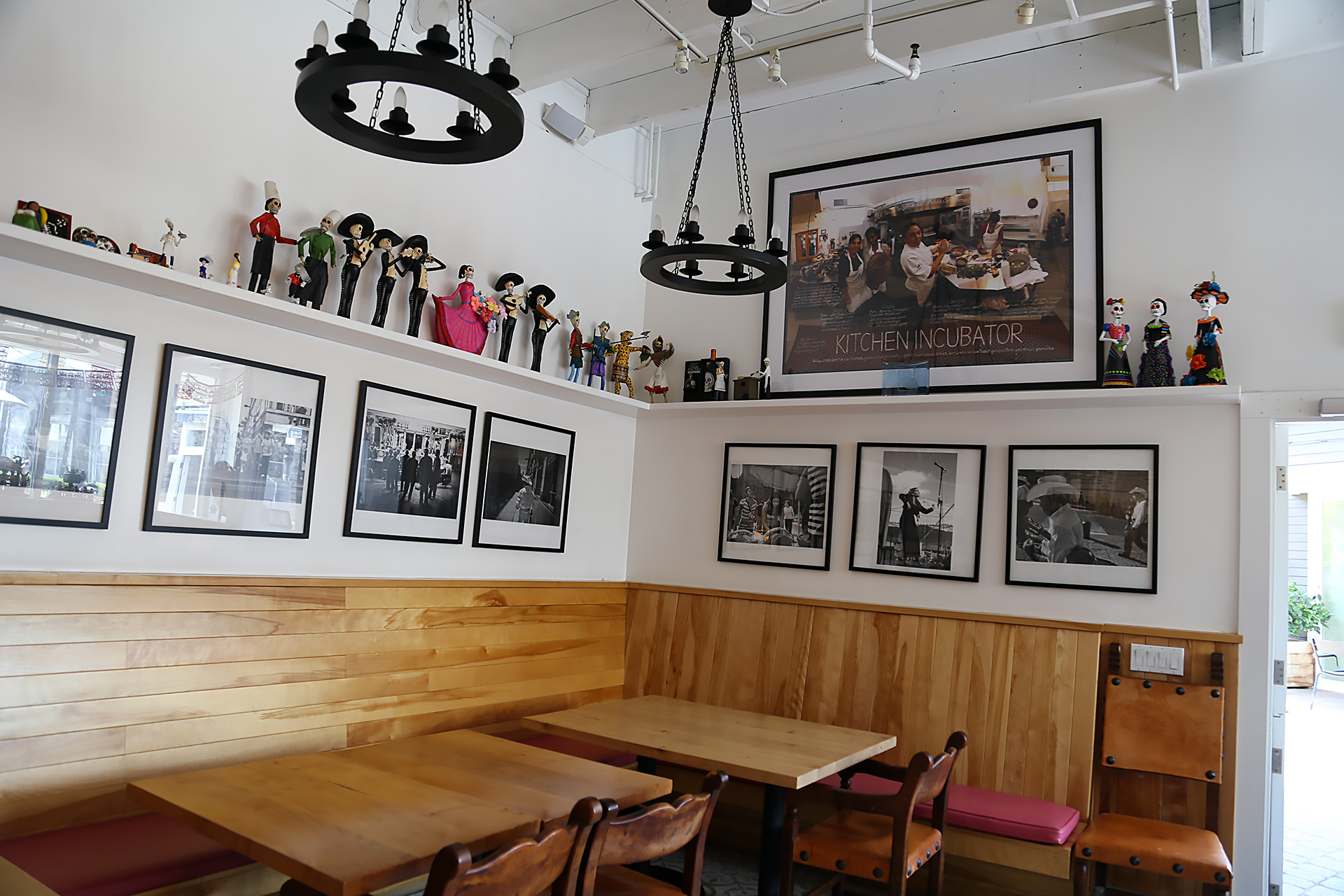 Inside El Huarache Loco with 2011 photo of her in La Cocina incubator's kitchen on the wall.
