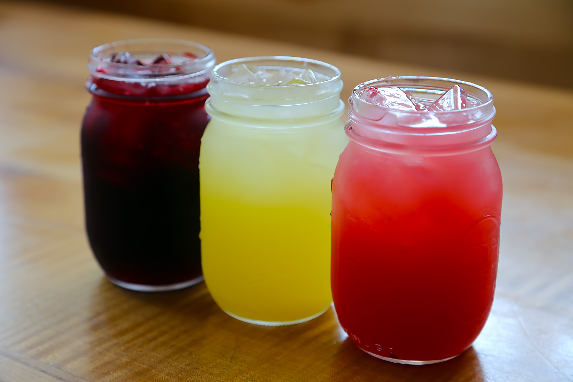 Agua frescas are housemade: jimica (hibiscus), pineapple and watermelon.
