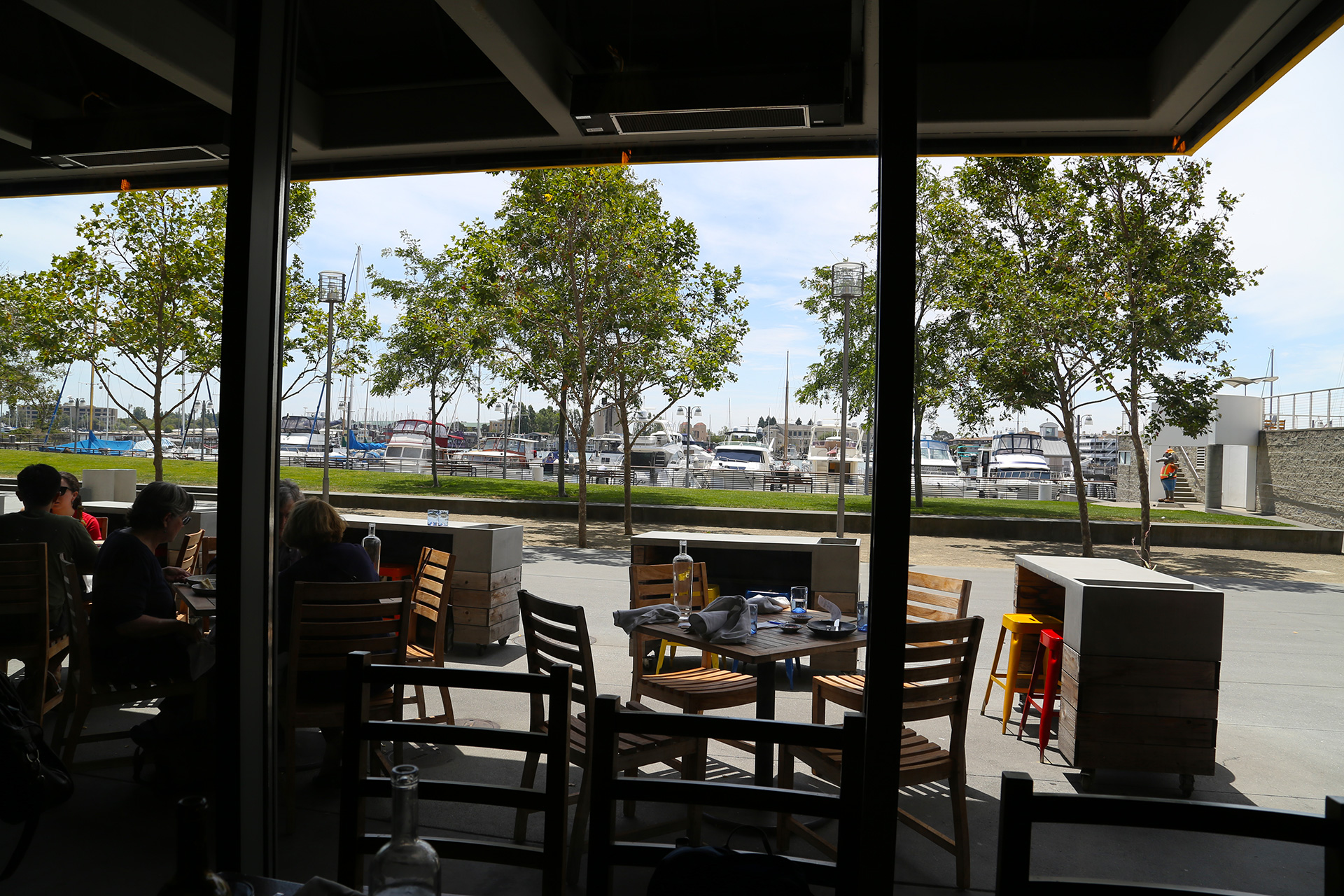 View of outdoor patio and Oakland Estuary in Jack London Square.