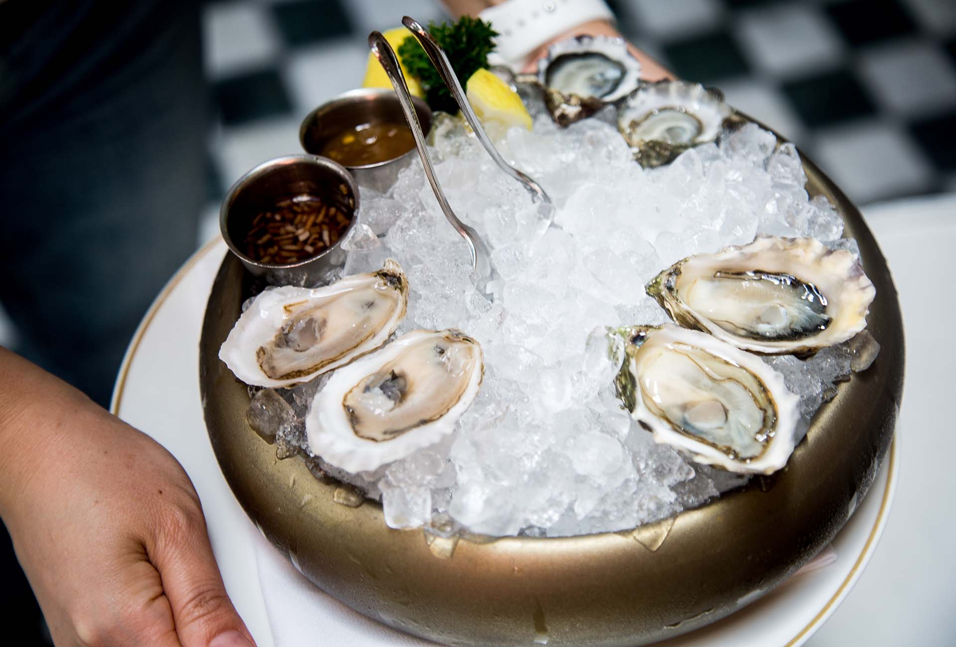 Oysters from the raw bar range from four to five dollars