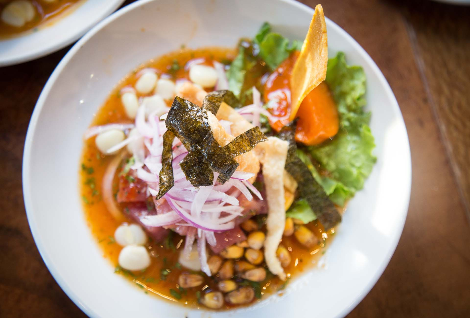 The Chino-Peruano Cebiche is served with a sweet rocoto pepper sauce and wonton chips