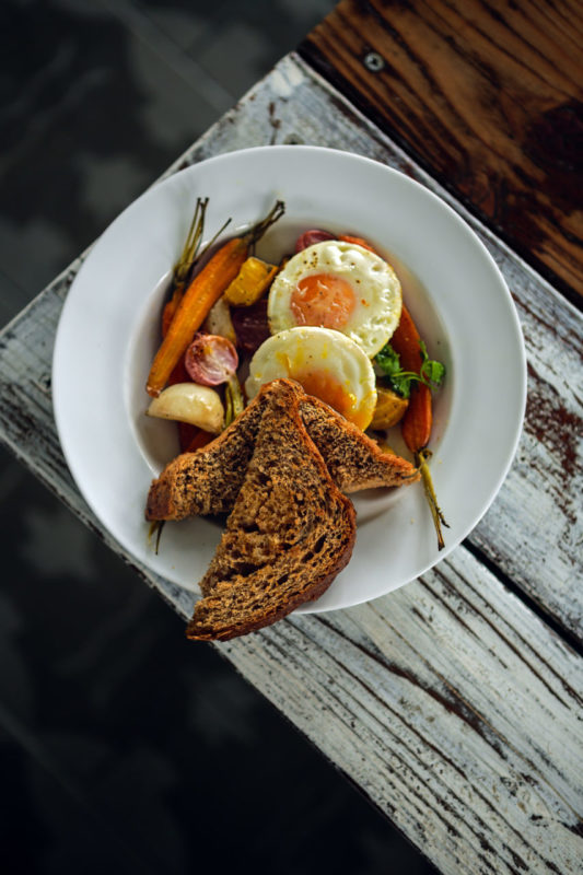 The Roots breakfast with eggs, roasted fall veggies and cracked whole wheat toast