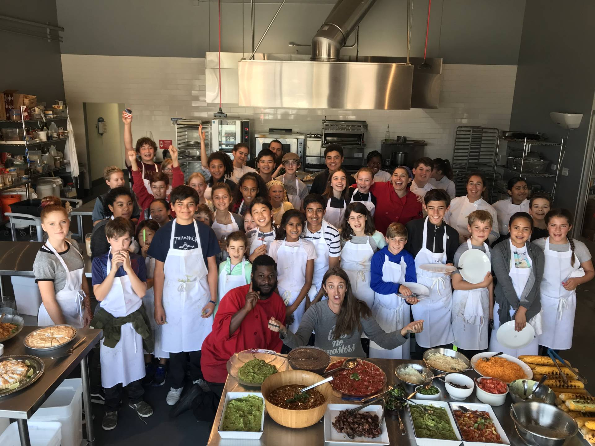 Students at Cook! Program pose for a group shot during a course.