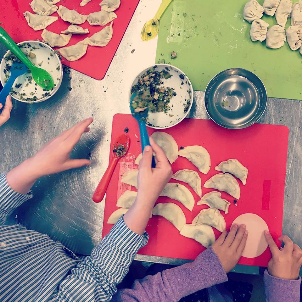 Children learn how to make their own pot stickers.