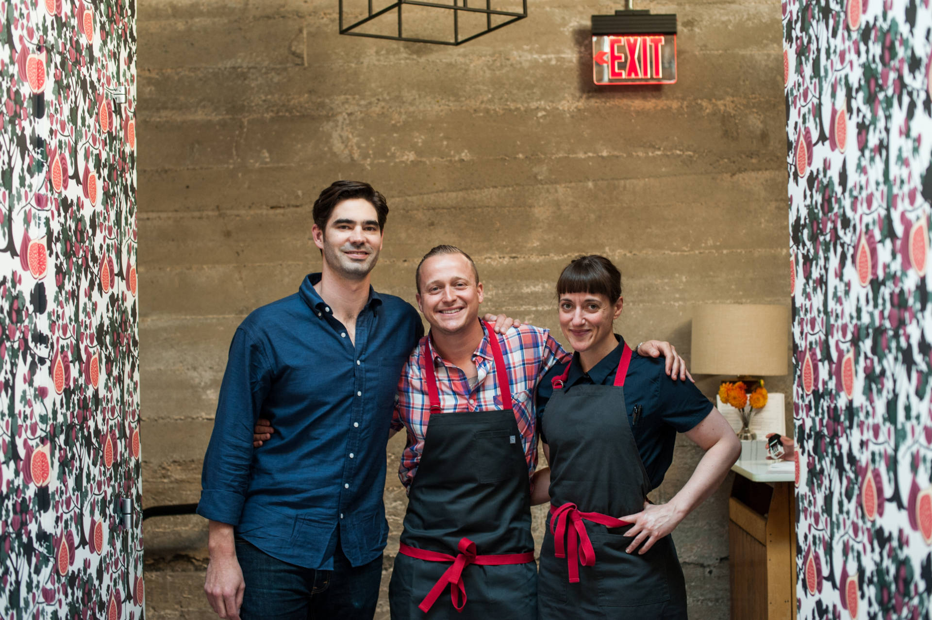 Angela Pinkerton with her restaurant partners, David Nayfeld and Matthew Brewer.