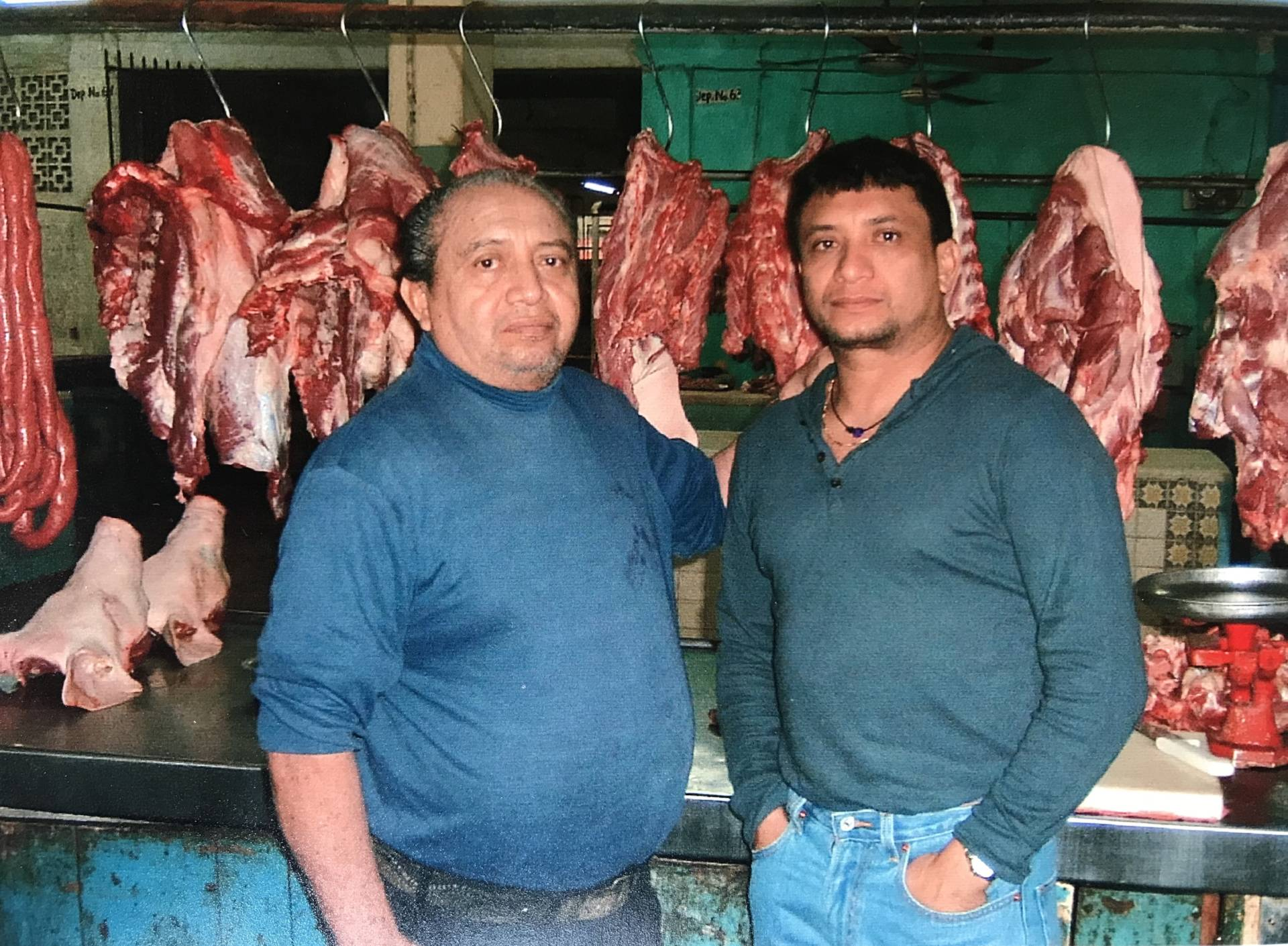 Mateo and father in the butchery