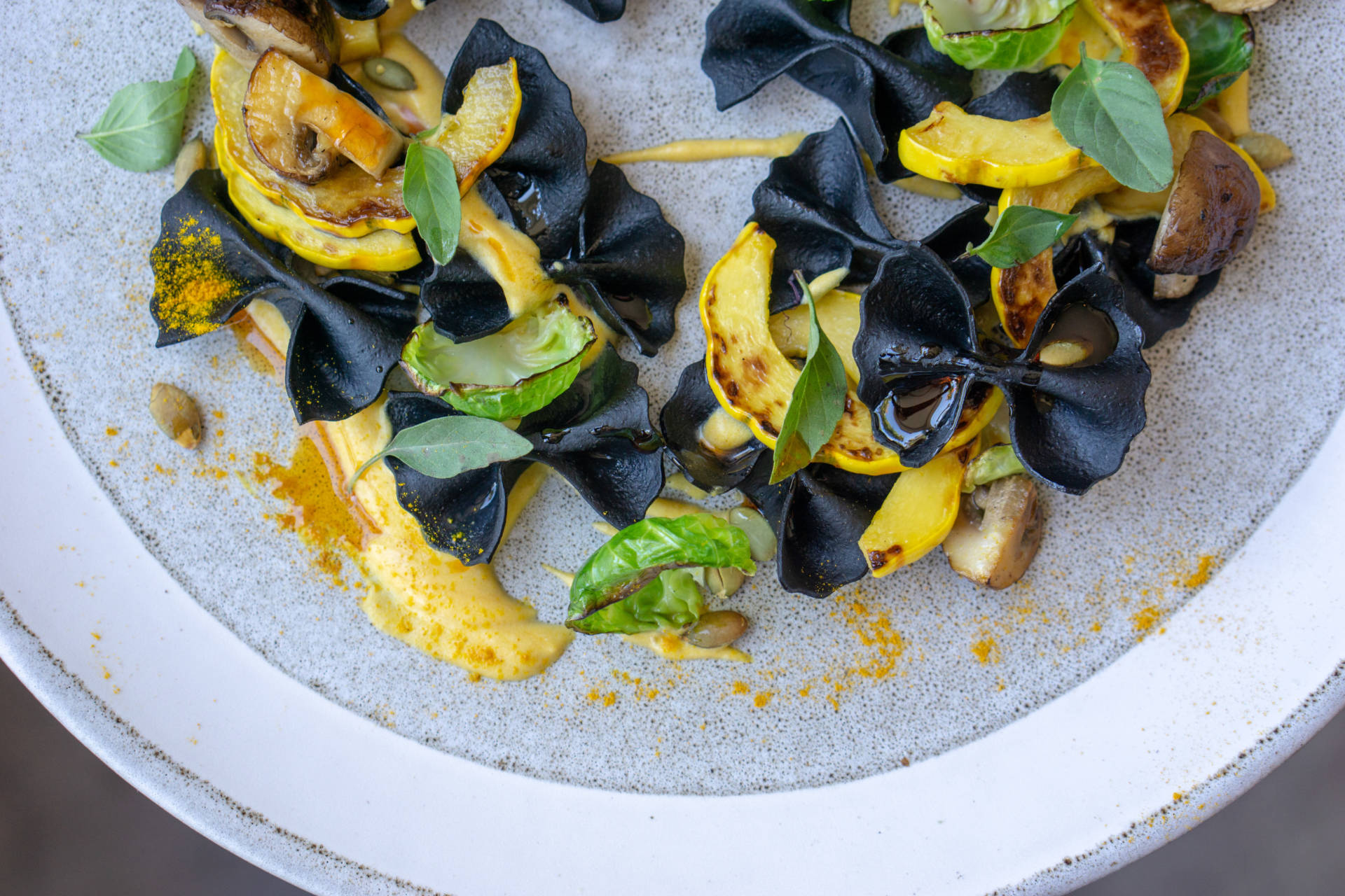 The charcoal farfalle dish from Merchant Roots.