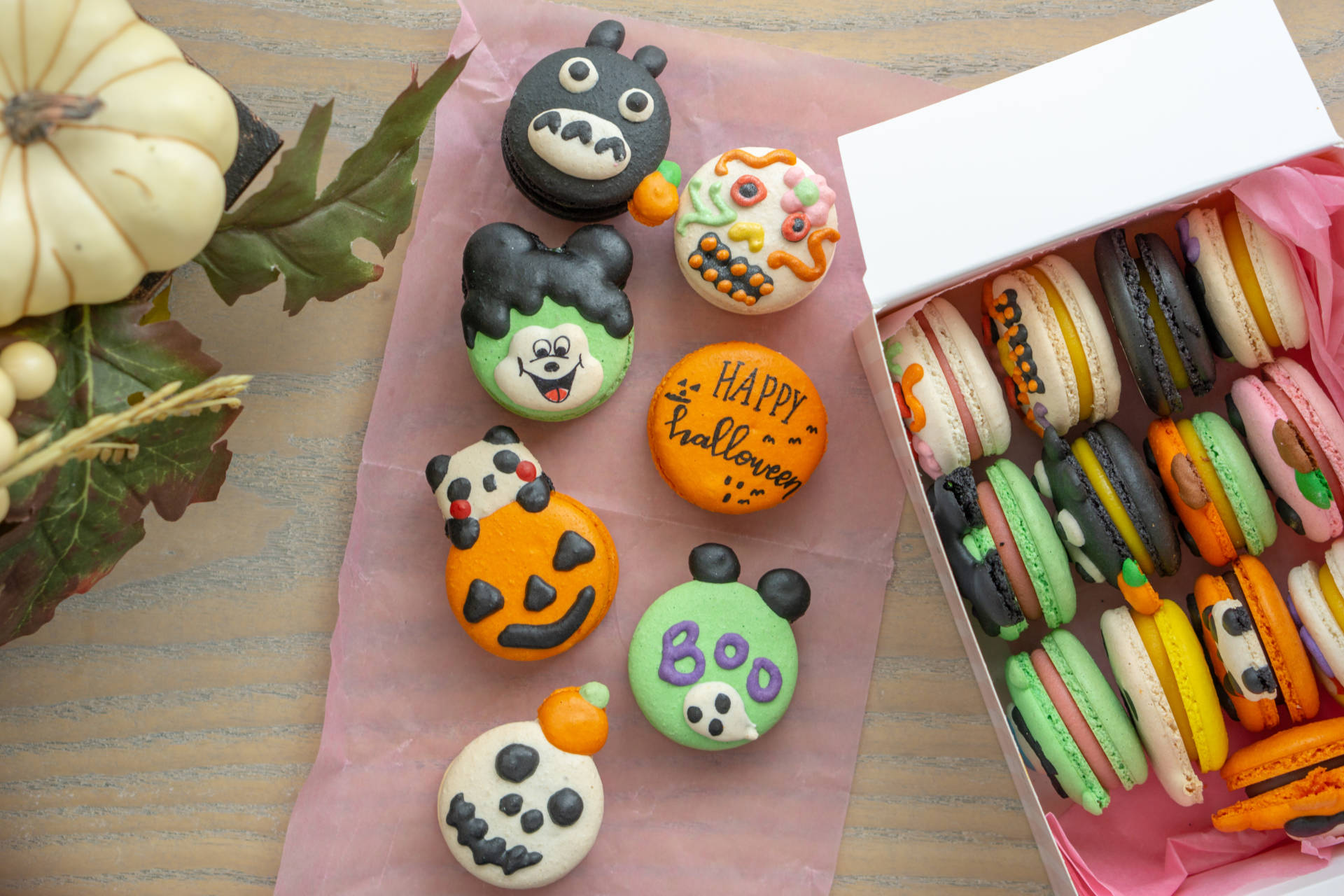 An assortment of Halloween macarons in guava, strawberry, chocolate, mango and more.