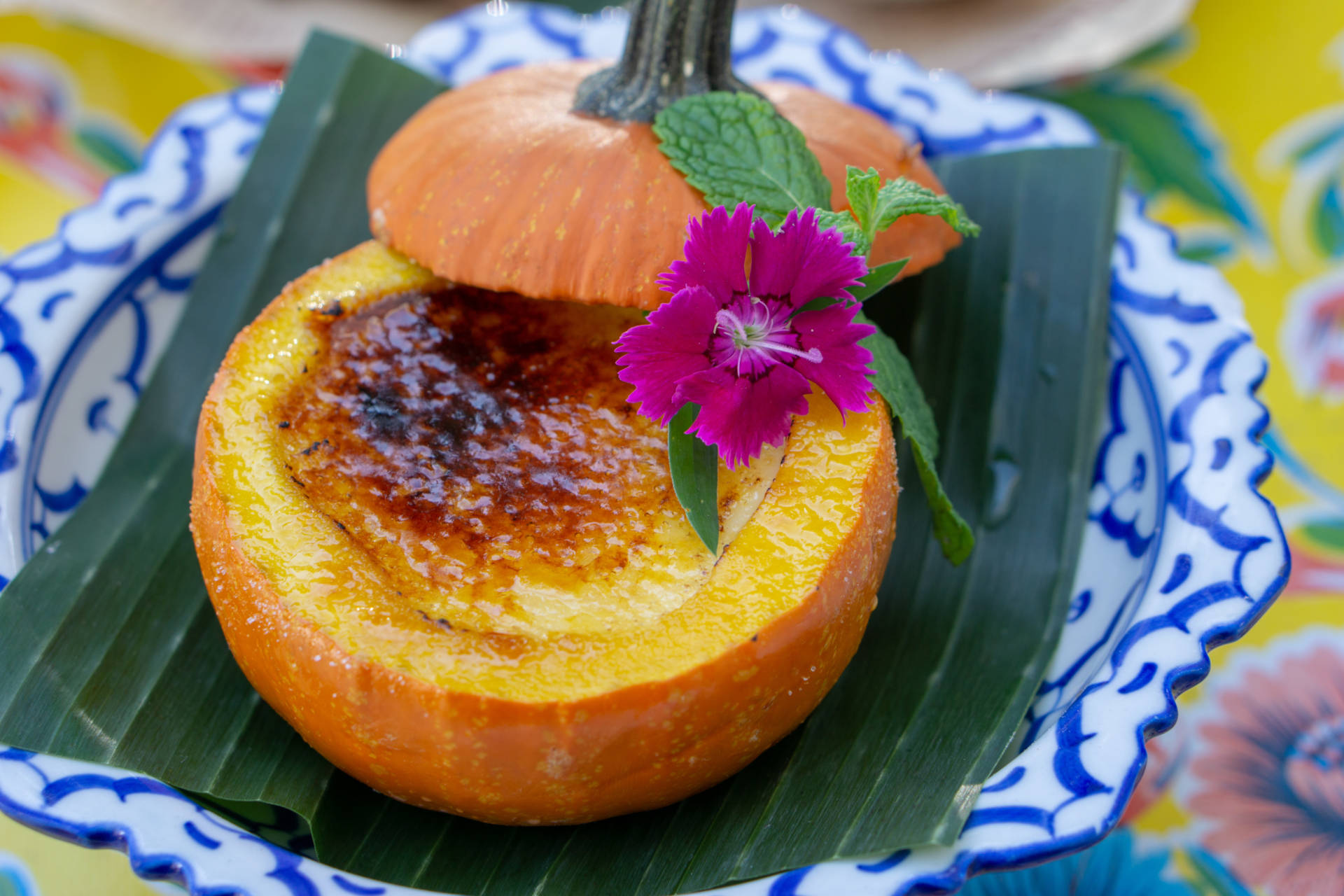 Pumpkin Creme Brulee is served up in a real pumpkin, dainty and delicious.