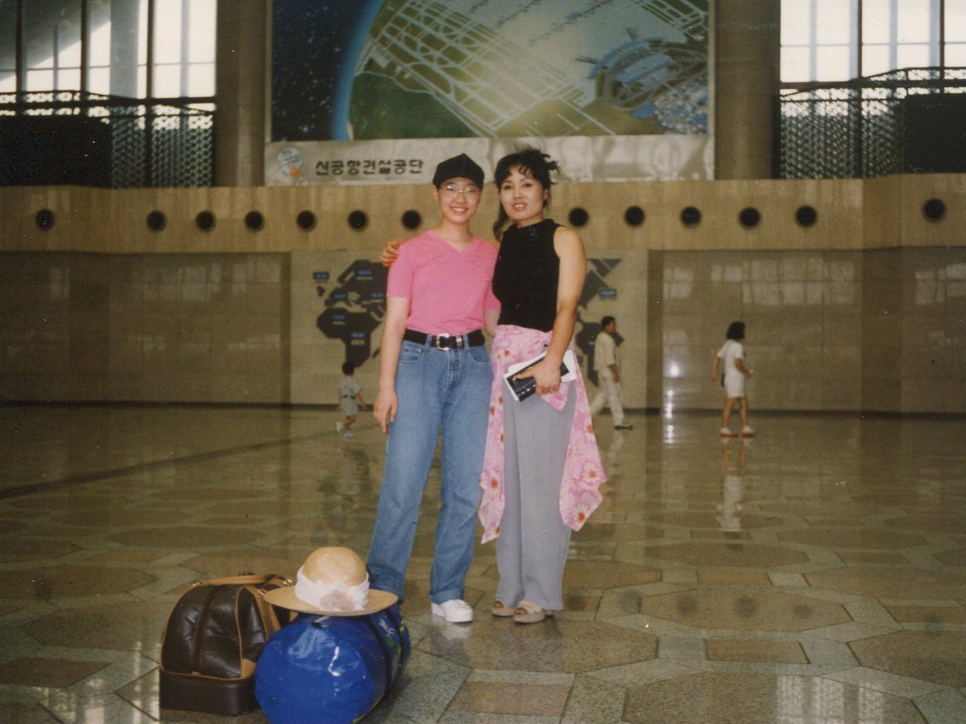 Robin Ha and her mother, Cassie, at an airport in South Korea, on their way to the U.S., in 1995.