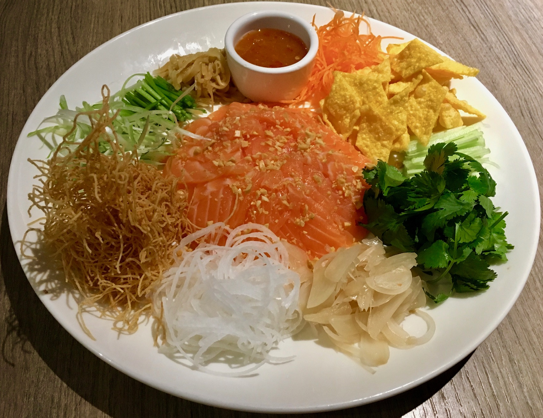 """The """"Prosperity Toss,"""" a Cantonese-style raw fish salad."""