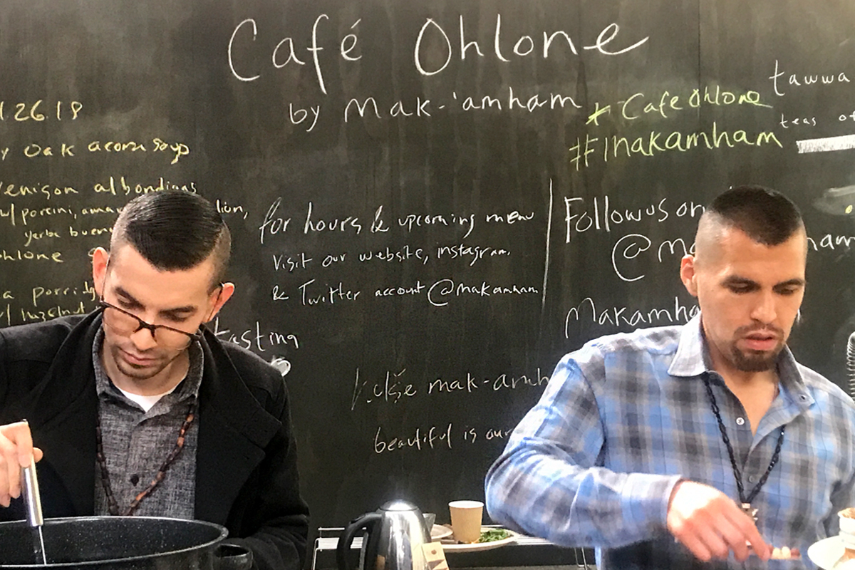 Louis Trevino (left) and Vincent Medina (right) cooking at Café Ohlone by mak'amham.