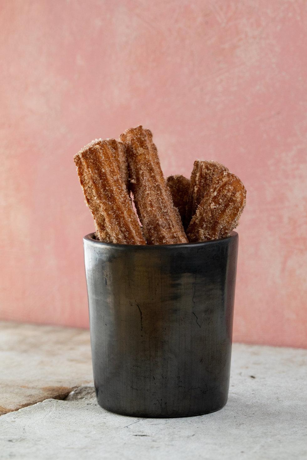 Churros are a dessert staple at La Calenda.