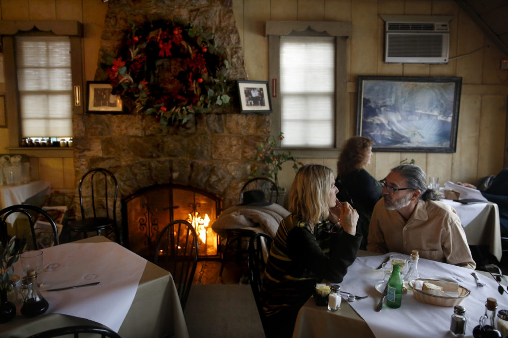 A fire burns in the dining room of Cafe Citti in Kenwood, on Monday, December 21, 2015.