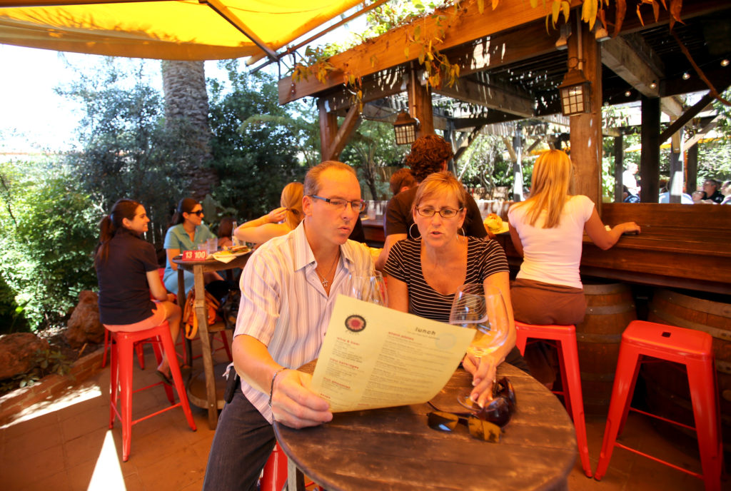 Archie Raines, left,  and Celeste Raines, both of Nashville, check out the menu at Sunflower Caffe in Sonoma, July 21, 2012.