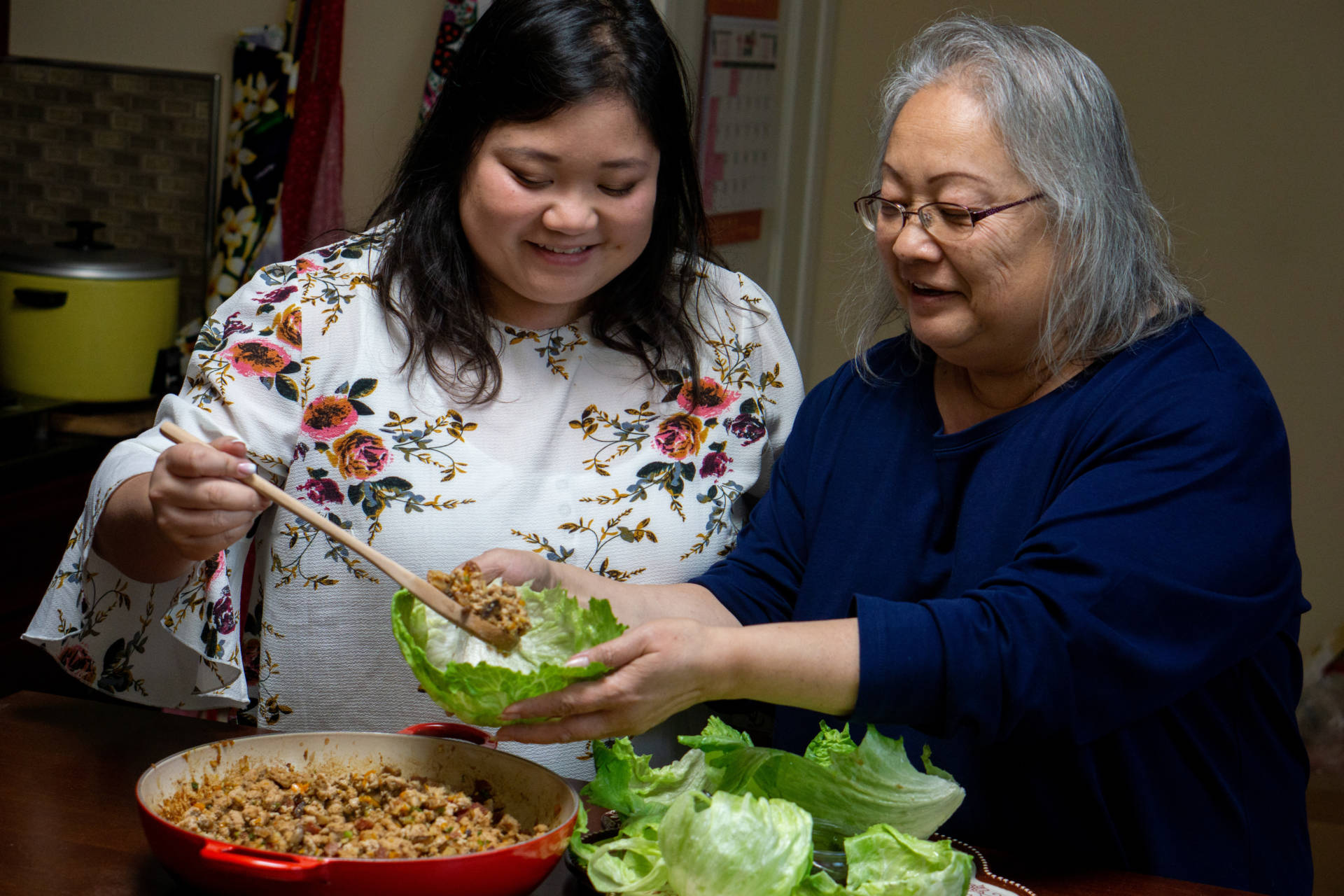 Cheryl and her mother, Diana, serve up some lettuce wraps.