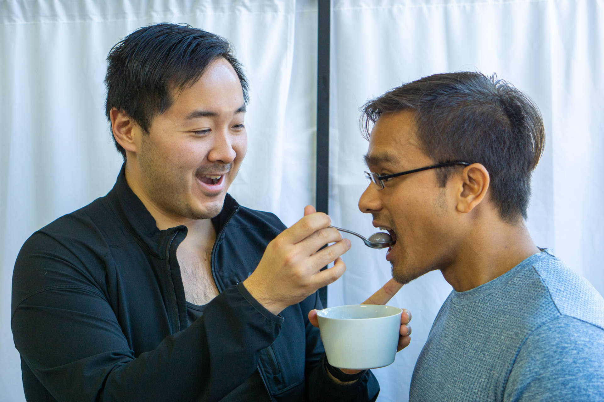 Wenter feeds Sam some freshly cooked tang yuan.