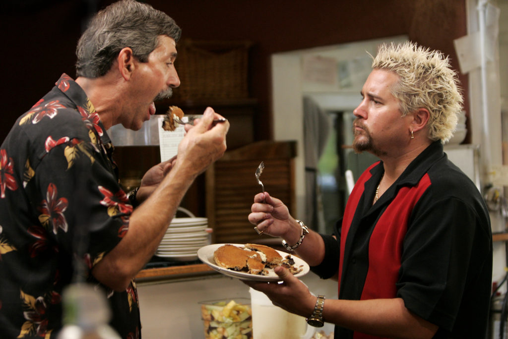 """Guy Fieri shares blueberry pancakes with Hank Vance, the owner of Hank's Creekside Restaurant, on May 2 during taping of his new show, """"Diners, Drive-ins and Dives.''"""